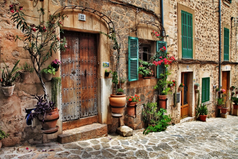 Valldemossa - one of the prettiest Mallorca towns with stone townhouses, green shutters and fresh plants