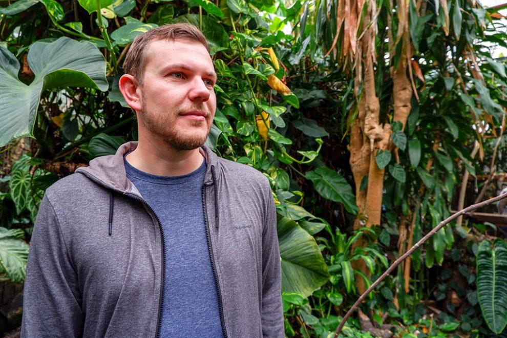 Man wearing hoodie in the jungle