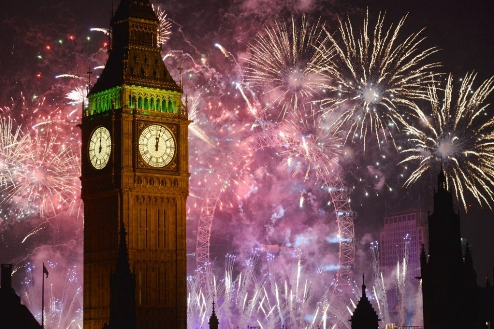 Big Ben's Clock Tower in London with New Year's Eve fireworks - one of the best places to spend New Year's Eve in Europe