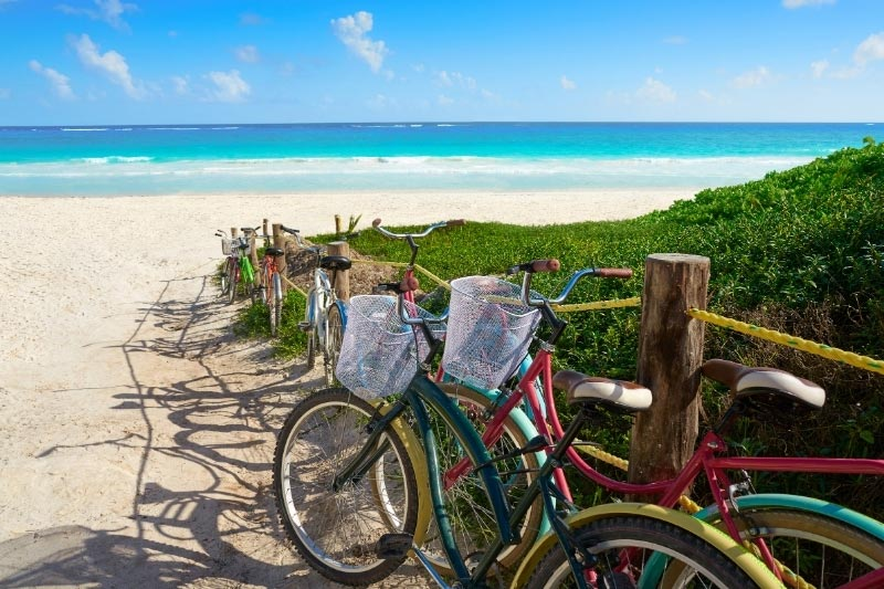 Many places to stay in Tulum offer bike rental to reach the beach